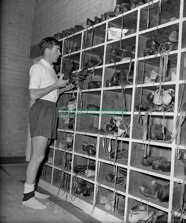 Tottenham captain Danny Blanchflower selects his boots for a practice match.