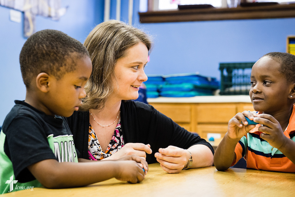 Principal Carrie Miller plays with a modeling compound with students Za'chary and Elijah (right) at Mount Calvary Lutheran School on Wednesday, May 28, 2014, in Milwaukee, Wis. LCMS Communications/Erik M. Lunsford