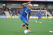AFC Wimbledon striker Lyle Taylor (33) dribbling during the EFL Sky Bet League 1 match between AFC Wimbledon and Plymouth Argyle at the Cherry Red Records Stadium, Kingston, England on 21 October 2017. Photo by Matthew Redman.