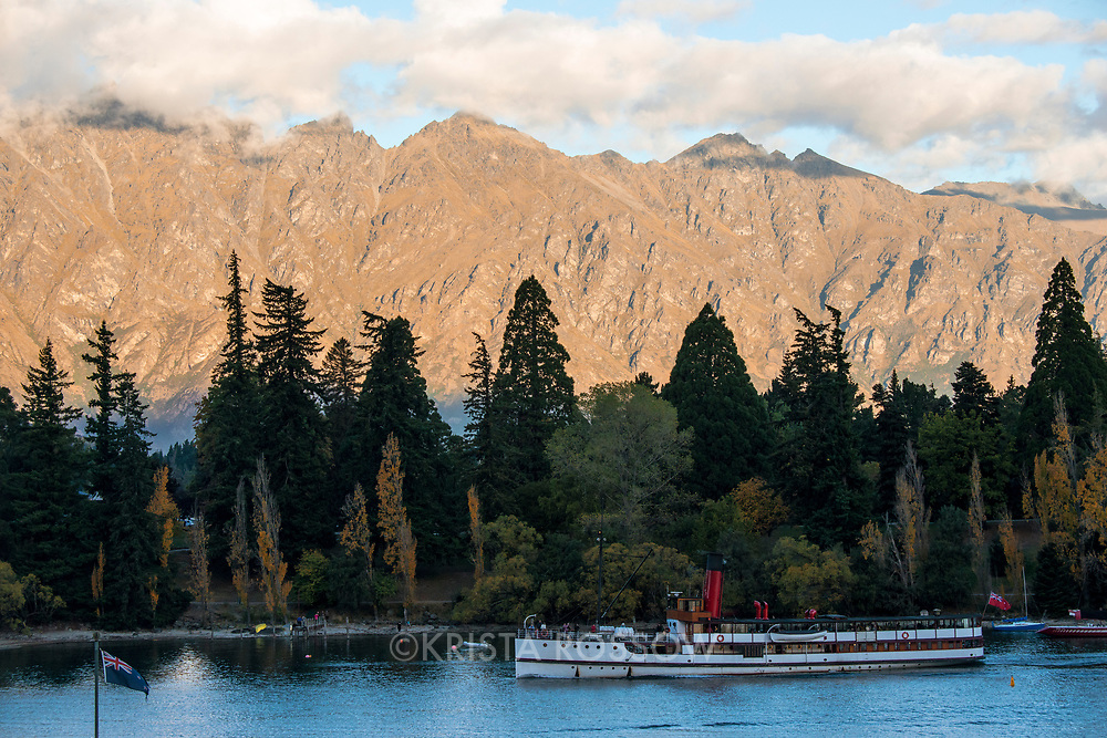 Scene along the waterfront of Lake Wakatipu in Queenstown on the South Island of New Zealand.
