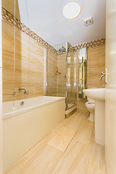 The smart, modern bathroom in Antony Zomparelli's flat in Islington, which he bought through Right-To-Buy in 2014, but has now been asked to pay more than twice the price after the council mistakenly sold it to him as a one bedroom flat, a small 8ft x 8ft box room being considered a second bedroom. London, February 04 2019.