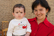Uzbekistan, Khiva. Mother with child.