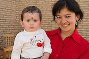Uzbekistan, Khiva. Mother with child.