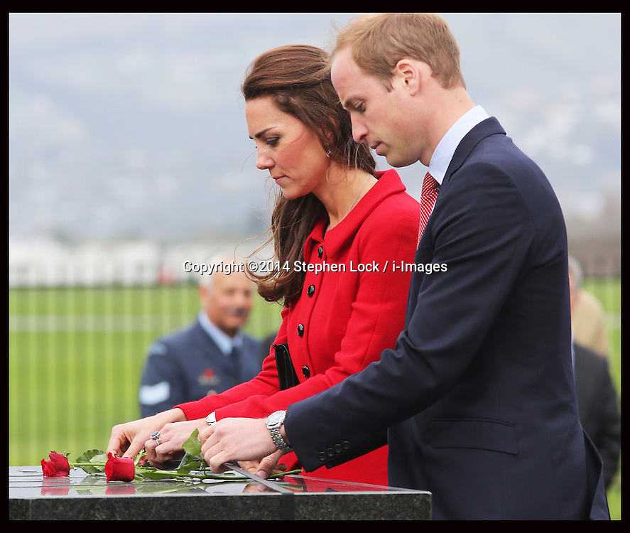 The  Duke and Duchess of Cambridge lays roses at the RNZAF Memorial Wall at Air Force Museum, Wigram in  Christchurch, New Zealand, Monday, 14th April 2014. Picture by Stephen Lock / i-Images