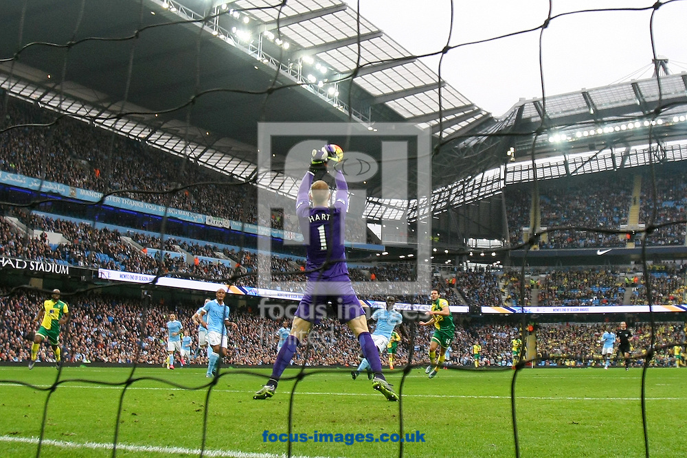 Joe Hart of Manchester City saves from Matt Jarvis of Norwich during the Barclays Premier League match at the Etihad Stadium, Manchester<br /> Picture by Paul Chesterton/Focus Images Ltd +44 7904 640267<br /> 31/10/2015