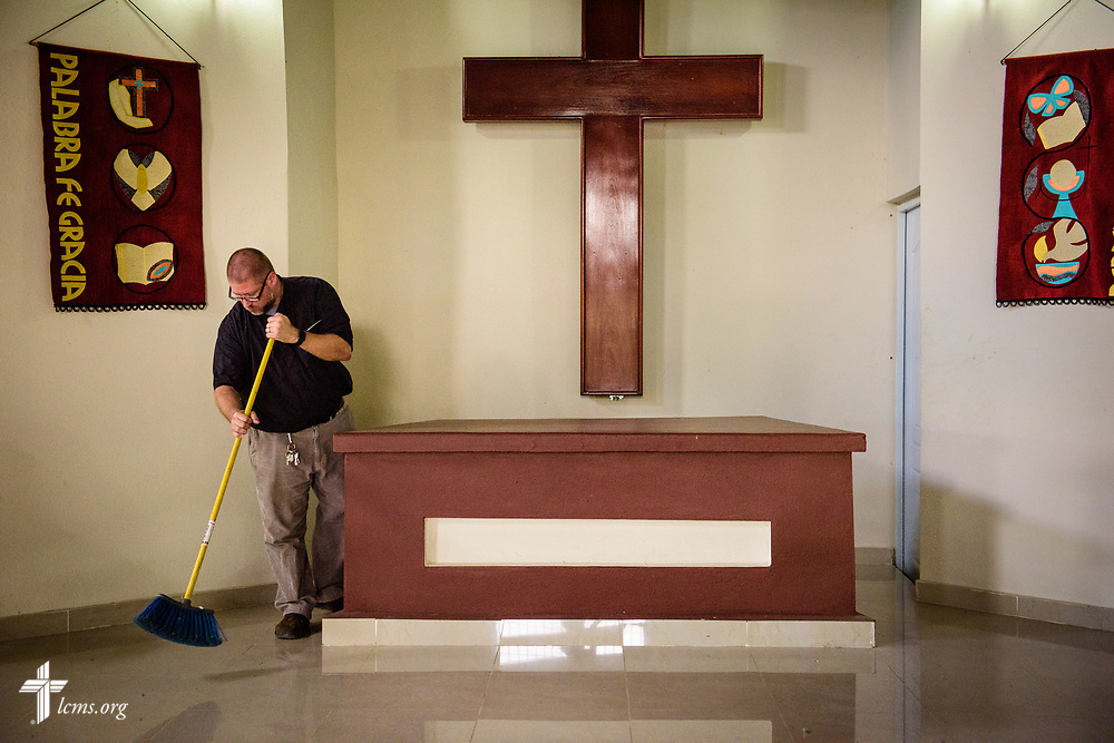 The Rev. Joel Fritsche, LCMS missionary to the Dominican Republic, sweeps the area next to the altar in his parish, Amigos de Cristo Iglesia Luterana in Las Americas (Friends of Christ Lutheran Church in the Americas) on Saturday, March 18, 2017, in Santo Domingo. LCMS Communications/Erik M. Lunsford