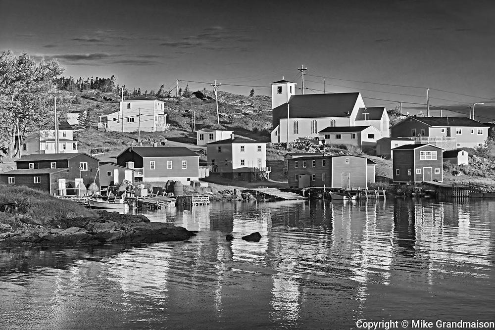 Reflection of village in  in Bonavista Bay, Salvage, Newfoundland & Labrador, Canada