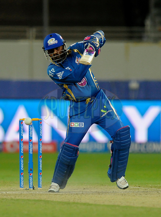 Harbhajan Singh of the Mumbai Indians bats during match 20 of the Pepsi Indian Premier League Season 2014 between the Mumbai Indians and the Sunrisers Hyderabad held at the Dubai International Stadium, Dubai, United Arab Emirates on the 30th April 2014<br /> <br /> Photo by Pal Pillia / IPL / SPORTZPICS