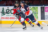 KELOWNA, CANADA - NOVEMBER 30: Nick Merkley #10 of the Kelowna Rockets checks Cole Ully #21 of the Kamloops Blazers on November 30, 2013 at Prospera Place in Kelowna, British Columbia, Canada.   (Photo by Marissa Baecker/Shoot the Breeze)  ***  Local Caption  ***
