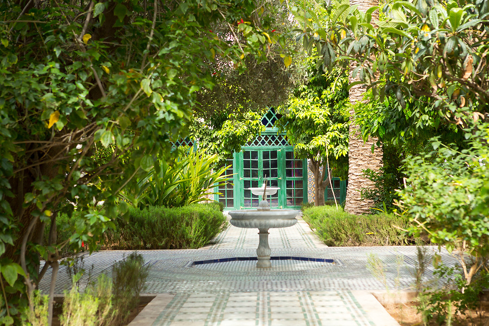 """Bahia Palace riad garden courtyard space, Marrakesh, Morocco, 2016–04-21.<br /><br />The name Bahia means """"brilliance"""" and the Bahia palace was built with the intention of being the most brilliant palace of its time. Built by two different generations - Si Moussa and his son, the overall design and layout is slightly random and unorganised. The materials used to make the intricate displays of zelij, ceramic and wood work through out the palace were sourced from across the Maghreb."""