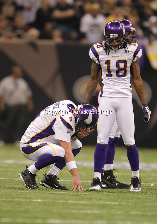 Jan 24, 2010; New Orleans, LA, USA; Minnesota Vikings wide receiver Sidney Rice (18) checks on quarterback Brett Favre (4) during a 31-28 overtime victory by the New Orleans Saints over the Minnesota Vikings in the 2010 NFC Championship game at the Louisiana Superdome. Mandatory Credit: Derick E. Hingle-US PRESSWIRE