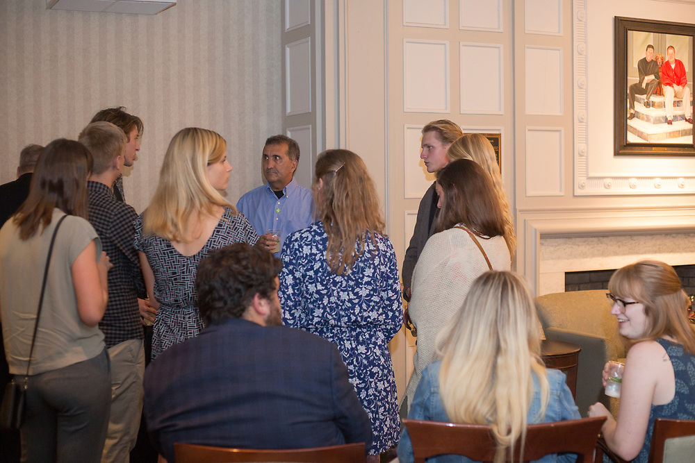 Pete Souza talks with students before the start of the President's Reception in Chaddock Alumni Room on September 19, 2017.
