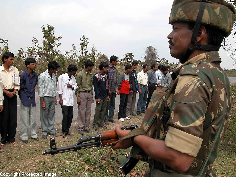 INDIA-INDEPENDENCE-SECURITY .Soldiers of the Indian Security Force are checking/searching the bus passengers at Alomganj, about 283 kilometres south-west of Guwahati, capital of the north-eastern Indian state of Assam, 21 January, 2006. Fifteen persons were badly hurt in a rebel blast near oil refinery yesterday, while few days ago the most dreaded militant groups of Northeast India - United Liberastion Front of Asam (that is, ULFA) gave a letter to the one of the Inidan oil company, Oil & natural Gas Commission (ONGC) to paid them more than 500 crores of rupees. Although, the attack was happened ahead of India's Republic Day on 26 January, police said. About two-dozen rebel groups in India's eastern region are fighting for secession and routinely boycott Republic Day. AFP PHOTO/Shib Shankar Chatterjee