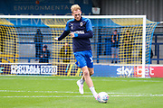 AFC Wimbledon midfielder Mitchell (Mitch) Pinnock (11) warmoing up during the EFL Sky Bet League 1 match between AFC Wimbledon and Lincoln City at the Cherry Red Records Stadium, Kingston, England on 2 November 2019.