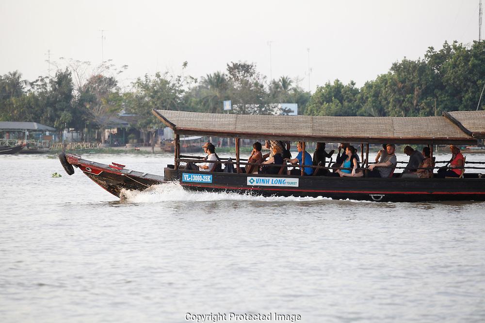 A tourist San Pan along the Mekong River in Vietnam<br /> <br />  photo by Dennis Brack