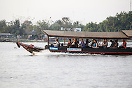 A tourist San Pan along the Mekong River in Vietnam<br /> <br />  photo by Dennis Brack