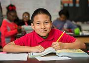 Mario Alvarado poses for a photograph at Foster Elementary School, February 12, 2015.