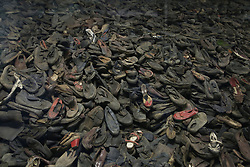 Shoes in display case in Block 5 at Auschwitz-Birkenau Memorial and Museum in Auschwitz, Poland on September 3, 2017. Auschwitz concentration camp was a network of German Nazi concentration camps and extermination camps built and operated by the Third Reich in Polish areas annexed by Nazi Germany during WWII. It consisted of Auschwitz I (the original camp), Auschwitz II–Birkenau (a combination concentration/extermination camp), Auschwitz II–Monowitz (a labor camp to staff an IG Farben factory), and 45 satellite camps. In September 1941, Auschwitz II–Birkenau went on to become a major site of the Nazi Final Solution to the Jewish Question. From early 1942 until late 1944, transport trains delivered Jews to the camp's gas chambers from all over German-occupied Europe, where they were killed en masse with the pesticide Zyklon B. An estimated 1.3 million people were sent to the camp, of whom at least 1.1 million died. Around 90 percent of those killed were Jewish; approximately 1 in 6 Jews killed in the Holocaust died at the camp. Others deported to Auschwitz included 150,000 Poles, 23,000 Romani and Sinti, 15,000 Soviet prisoners of war, 400 Jehovah's Witnesses, and tens of thousands of others of diverse nationalities, including an unknown number of homosexuals. Many of those not killed in the gas chambers died of starvation, forced labor, infectious diseases, individual executions, and medical experiments. In 1947, Poland founded a museum on the site of Auschwitz I and II, and in 1979, it was named a UNESCO World Heritage Site. Photo by Somer/ABACAPRESS.COM