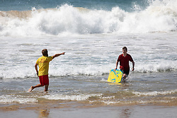 © Licensed to London News Pictures. 31/05/2020. Padstow, UK. A RNLI Lifeguard gives advice to a bodyboarder on Constantine Bay beach on the north coast of Cornwall this afternoon. Yesterday the RNLI reinstated their beach lifeguard service, having not provided the usual lifeguard service for this time of year in Cornwall, due to Coronavirus (COVID-19). Photo credit : Tom Nicholson/LNP