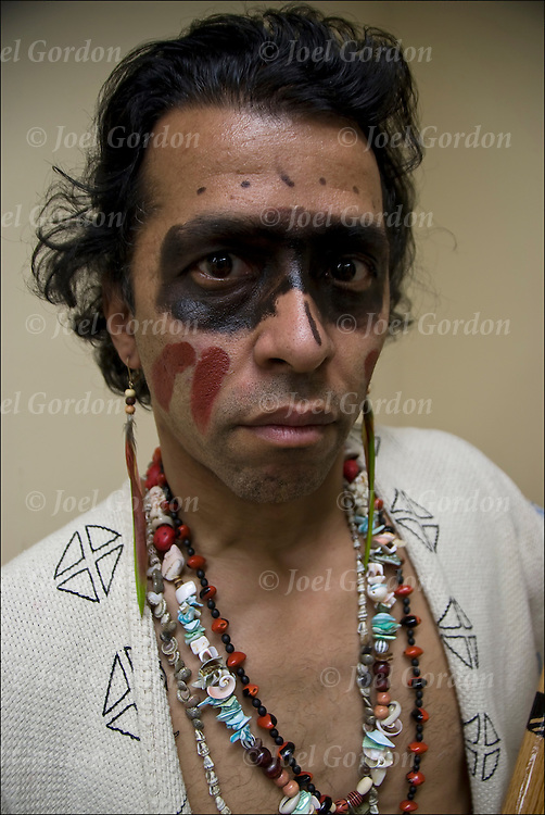 Portrait of Taino Native American from the Island of (Boriken) Puerto Rico  dressed in pow wow regalia for traditional dance social with the Thunderbird Indian Dancers and Singers at the Nation Museum of American Indian in New York City.<br /> <br /> Release # 2553