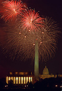 Fireworks during Indepedence Day celebrations in Washington, DC over the Lincoln Memorial, Washington Monument and Capital building.