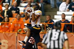 Oct 21, 2011; Syracuse NY, USA;  West Virginia Mountaineers wide receiver Brad Starks (2) catches a pass for a touchdown over Syracuse Orange cornerback Kevyn Scott (26) during the fourth quarter at the Carrier Dome.  Syracuse defeated West Virginia 49-23. Mandatory Credit: Jason O. Watson-US PRESSWIRE