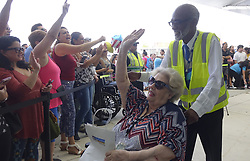 October 3, 2017 - Fort Lauderdale, Florida, U.S. - A Caribbean hurricane evacuee who arrived on board the Royal Caribbean Adventure of the Seas, reacts to the waiting crowd, Tuesday, at Port Everglades. More than 3,000 people from Puerto Rico and the U.S. Virgin Islands were brought to Florida on board the Royal Caribbean Adventure of the Seas. (Credit Image: © Joe Cavaretta/TNS via ZUMA Wire)