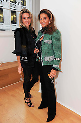 Left to right, SIOBHAN LOUGHRAN and JORIE GRASSIE at a pre lunch reception to celebrate the launch of the new Louisa Guinness gallery at Ben Brown Fine Art, Cork Street, London on 18th November 2009.