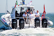 Owner of Prada and Team Principal behind the Luna Rossa, Patrizio Bertelli (white hair) sits on the aft of the support boat for the Italian contestant in the Americas Cup. While the sailboats in the Cup are the fastest in the world, the support boat is pretty fast too. Equipped with four 300 hp Mercury Verado outboards, the RIB can both keep up with the pace of the Prada sponsored Luna Rossa Piranha catamaran, and tow it if necessary.<br /> An avid fan, sailor and sponsor of the sport, Bertelli followed the finale of the 34th America's Cup from the aft of the rib as the two remaining contestants, New Zealand's Emirates and the Oracle Team owned by billionaire Larry Ellison, battled it out in the San Francisco Bay.