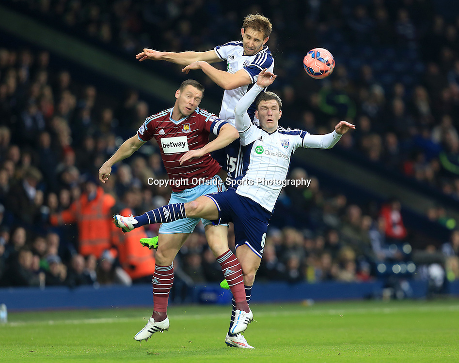 14th February 2015 - FA Cup 5th Round - West Bromwich Albion v West Ham United - Craig Dawson of West Bromwich Albion climbs highest to win a header from Kevin Nolan of West Ham United and Craig Gardner of West Bromwich Albion - Photo: Paul Roberts / Offside.