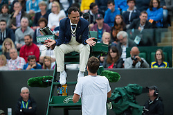 LONDON, ENGLAND - Monday, July 4, 2016:  Tomas Berdych (CZE) is complaining to the umpire that they should stop playing as the light is so dark - Gentlemen's Single 4th Round match on day eight of the Wimbledon Lawn Tennis Championships at the All England Lawn Tennis and Croquet Club. (Pic by Kirsten Holst/Propaganda)