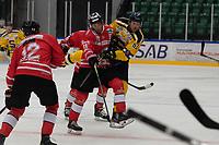 2019-08-14 | Nyköping, Sweden: Nyköping SK (11) Christian Axelsson Södertäle  SK (61) Martin Janolhs during the game between Nyköping SK and Södertälje SK at Nyköping Arena ( Photo by: Simon Holmgren | Swe Press Photo )<br /> <br /> Keywords: Nyköping Arena, Nyköping, Ice hockey, Preseason game, Nyköping SK, Södertälje SK
