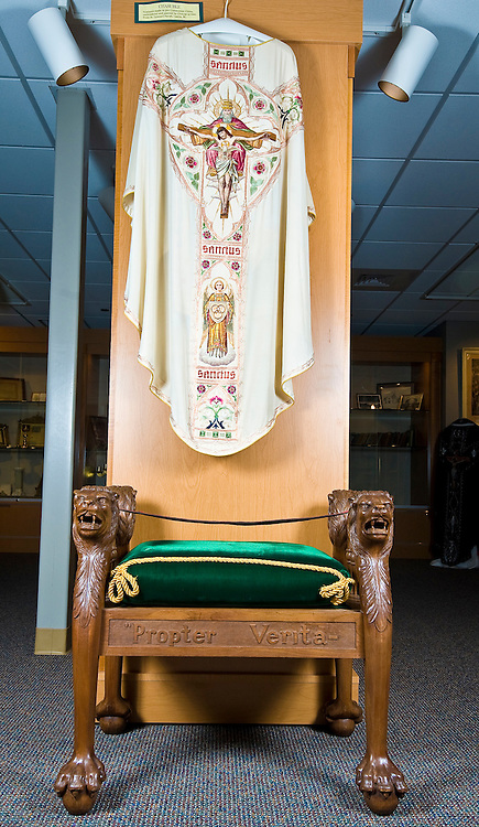 A vestment depicting the Holy Trinity, handmade by Catholics in China, was donated by St. Leonard Parish in Laona, one of five chasubles donated to the museum. Below the chasuble is a faldstool, used by the bishop during ordinations. (Sam Lucero | The Compass)