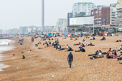© Licensed to London News Pictures. 18/05/2019. Brighton, UK.  Members of the public take to the beach in Brighton and Hove to take advantage of the milder weather on the South coast. Photo credit: Hugo Michiels/LNP