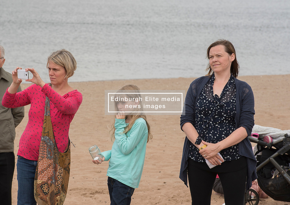 Portobello resident and former colleague of murdered MP Jo Cox, Kim Wallace, organised a tribute event on Portobello beach at which locals were invited to remember Jo and to light candles for her. Kim listeneing to the other tributes.<br /> <br /> <br /> © Jon Davey/ EEm