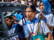 30 NOVEMBER 2017 - YANGON, MYANMAR: People on the street, who were not able to get into the cathedral, pray during the Papal Mass at St. Mary's Cathedral in Yangon. Thursday's mass was his last public appearance in Myanmar. From Myanmar the Pope went on to neighboring Bangladesh.    PHOTO BY JACK KURTZ