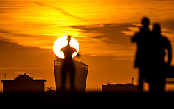 © Licensed to London News Pictures. 30/01/2018. London, UK. Visitors to the top of Primrose Hill enjoy the view as the sun rises above the skyscraper '20 Fenchurch Street'  in the City of London. Photo credit: Peter Macdiarmid/LNP