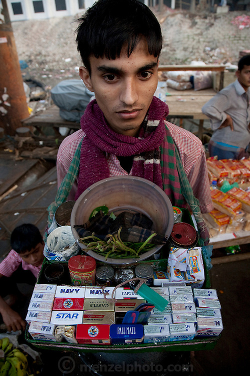A street vendor sells cigarettes at the Sadarghat dock on the Buriganga River in Dhaka, Bangladesh.