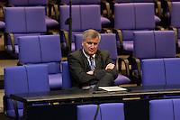 11 MAR 2004, BERLIN/GERMANY:<br /> Horst Seehofer, MdB, CSU, Gesundheitsminister a.D., sitzt allein in den hinteren Reihen der CDU/CSU Fraktion, vor Beginn der Bundestagsdebatte zur Finanzierung der Rentenversicherung, Plenum, Deutscher Bundestag<br /> IMAGE: 20040311-01-068