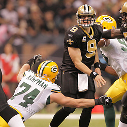 2008 November, 24: Green Bay Packers defensive end Aaron Kampman (74) pressures New Orleans Saints quarterback Drew Brees (9) as he gets off a pass in the first half of a Monday Night Football game at the Louisiana Superdome in New Orleans, LA.
