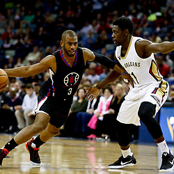 Dec 28, 2016; New Orleans, LA, USA;  Los Angeles Clippers guard Chris Paul (3) drives past New Orleans Pelicans guard Jrue Holiday (11) during the first quarter of a game at the Smoothie King Center. Mandatory Credit: Derick E. Hingle-USA TODAY Sports