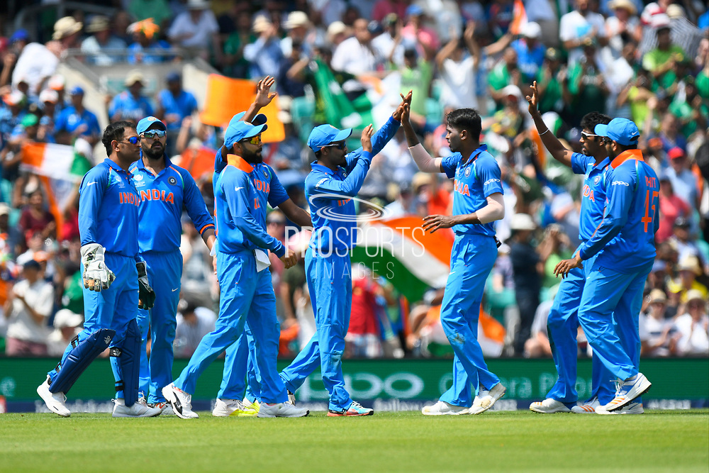 Wicket - Ravindra Jadeja of India celebrates taking the catch which dismissed Fakhar Zaman of Pakistan during the ICC Champions Trophy final match between Pakistan and India at the Oval, London, United Kingdom on 18 June 2017. Photo by Graham Hunt.