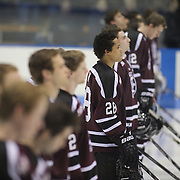 Noah Henry, number 28, and his Union College team mates during the Nation Anthem before the Yale Vs Union College, Men's College Ice Hockey game at Ingalls Rink, New Haven, Connecticut, USA. 28th February 2014. Photo Tim Clayton