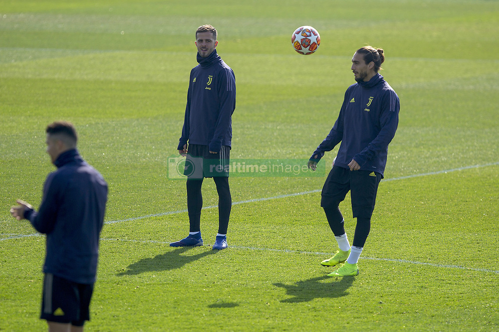 February 19, 2019 - Turin, Piedmont, Italy - Miralem Pjanic and Martin Caceres during the training on the eve of the first leg of eighth of final of UEFA Champions League match between Atletico Madrid and Juventus FC at Juventus Training Center on February 19, 2019 in Turin, Italy. (Credit Image: © Massimiliano Ferraro/NurPhoto via ZUMA Press)