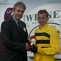Famous Grouse day at the races..15.05.02<br />Derek Brown, Director of the Famous Grouse Experience makes the presentation to the winning jockey of the Famous Grouse Experience Maisen Hurdle Race B Storey who rode Trivial<br /><br />For details please contact Emrys Inker at the Edrington Group on 01738 493781<br /><br />Pic by Graeme Hart<br />Copyright Perthshire Picture Agency<br />Tel: 01738 623350 / 07990 594431