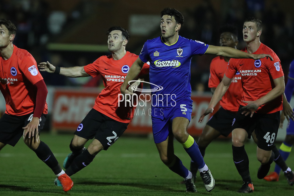 AFC Wimbledon defender Will Nightingale (5) and Brighton & Hove Albion striker Richie Towell (29) during the EFL Trophy match between AFC Wimbledon and U23 Brighton and Hove Albion at the Cherry Red Records Stadium, Kingston, England on 6 December 2016. Photo by Stuart Butcher.