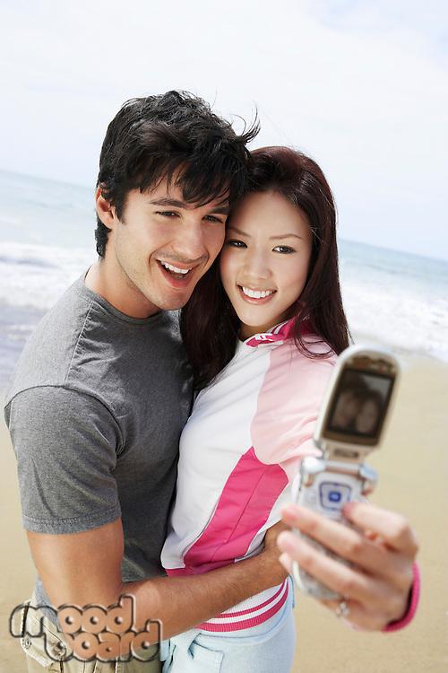 Couple Using Camera Phone