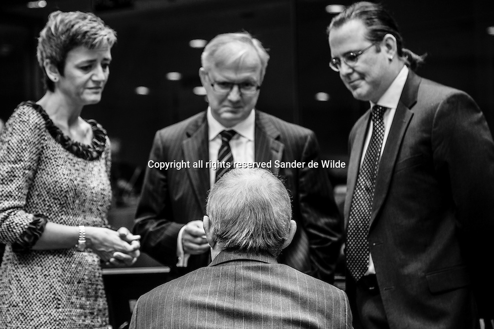 German Finance Minister Wolfgang Schaeuble seen on the back speaks with from left to rigth: Danish Finance minister Margrethe Vestager, EU Commissioner for Economic and  Monetary Affairs Olli Rehn and Sweden's Finance Minister Anders Borg during a meeting of EU finance ministers at the EU Council building in Brussels on Tuesday, Nov. 13, 2012. Shoring up Europe's banking sector and strengthening oversight of economic policies will likely top the agenda of a meeting Tuesday of the European Union's 27 finance ministers.