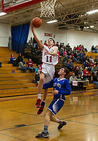 Laconia's Ryan Chandler goes for a layup against Inter Lakes' Davis Jollimore during NHIAA Division III basketball Tuesday evening.  (Karen Bobotas/for the Laconia Daily Sun)