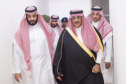 File photo - Saudi Arabia's Deputy Crown Prince and interior minister Prince Mohammad bin Nayef (R) and Defense Minister Prince Mohammed bin Salman bin Abdelaziz Al Saud (L) seen leading the operation Decisive Stormair campaign, launched against Houthi militants in Yemen, from the main command centre in Riyadh, Saudi Arabia, on March 26, 2015. Saudi Arabia's king has appointed his son Mohammed bin Salman as crown prince - replacing his nephew, Mohammed bin Nayef, as first in line to the throne. Prince Mohammed bin Nayef, 57, has been removed from his role as head of domestic security, state media say. A new Saudi anti-corruption body has detained 11 princes, four sitting ministers and dozens of former ministers, media reports say. The detentions came hours after the new committee, headed by Crown Prince Mohammed bin Salman, was formed by royal decree. Photo by Balkis Press/ABACA.